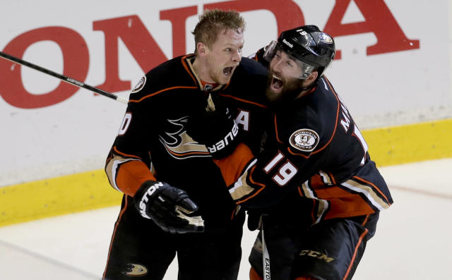 Anaheim Ducks right wing Corey Perry, left, celebrates his game winning goal the Patrick Maroon during overtime in Game 5 of an NHL hockey second-round playoff series against the Calgary Flames in Anaheim, Calif., Sunday, May 10, 2015. (AP Photo/Chris Carlson)