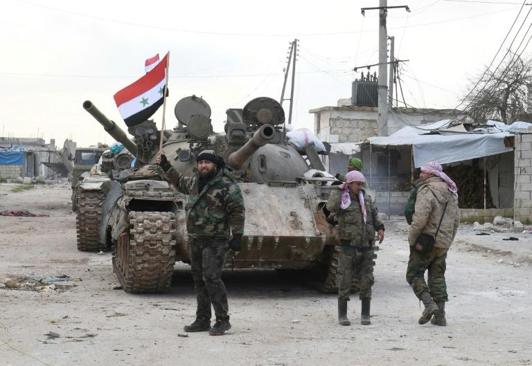 Syrian government forces deploy near the main Damascus-Aleppo highway as they establish full control of the strategic route for the first time since 2012