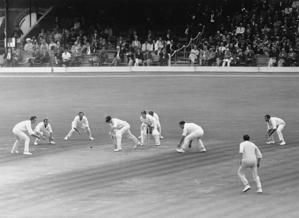 From left: Ted Dexter, John Edrich, Tom Graveney, Alan Knott, Colin Cowdrey, Colin Milburn and Basil D'Oliveira of England surround Australia's Ashley Mallett as he plays a forward defensive at the Oval in 1968 (Getty)