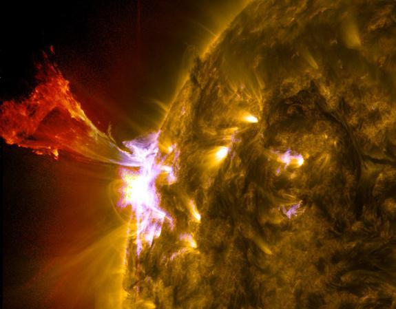 A burst of solar material leaps off the left side of the sun in what's known as a prominence eruption. This image combines three images from NASA's Solar Dynamics Observatory captured on May 3, 2013, at 1:45 pm EDT.