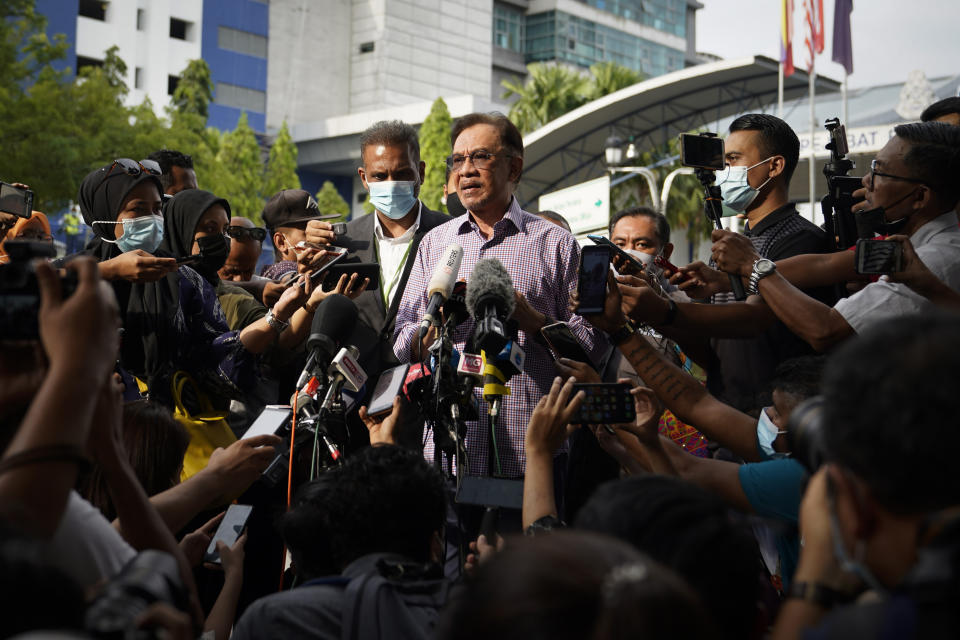 Malaysian opposition leader Anwar Ibrahim speaks to media after leaving the police headquarters in Kuala Lumpur, Malaysia, Friday, Oct. 16, 2020. Anwar was questioned by police over the dissemination of a purported list of lawmakers supporting his bid to oust the government. (AP Photo/Vincent Thian)