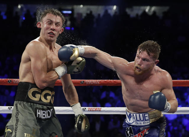 Canelo Alvarez (R) connects with a right to Gennady Golovkin during a middleweight title fight Saturday, Sept. 16, 2017, in Las Vegas. (AP Photo)