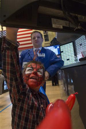 Trader David Vadala lets his son work at his trading post on the floor of the New York Stock Exchange November 29, 2013. REUTERS/Brendan McDermid