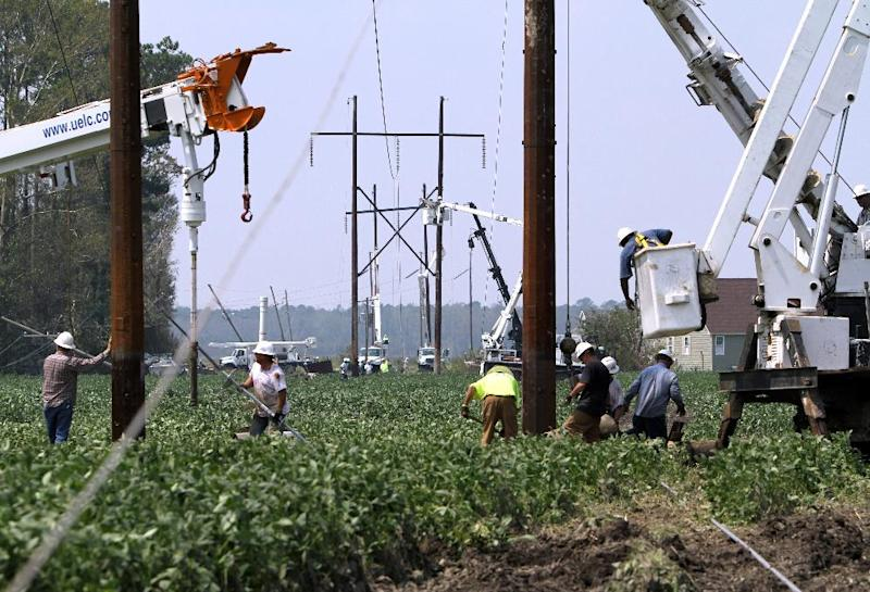 About 85 Progress Energy workers work in the field in Alliance, N.C. trying to restore the power in the region east of New Bern, N.C.  Monday, Aug.29, 2011. Thousands were still without power in eastern North Carolina in the wake of Hurricane Irene. (AP Photo/The News & Observer, Takaaki Iwabu) MANDATORY CREDIT