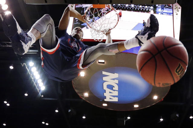Gonzaga forward Angel Nunez dunks during practice at the NCAA college basketball tournament Thursday, March 20, 2014, in San Diego. Gonzaga faces Oklahoma State in a second-round game on Friday. (AP Photo/Gregory Bull)
