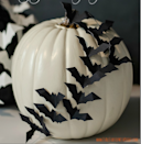 "<p>We love the clean look of this monochromatic pumpkin project from <a href=""http://www.itallstartedwithpaint.com/bats-flying-across-a-pumpkin/"" rel=""nofollow noopener"" target=""_blank"" data-ylk=""slk:It All Started With Paint."" class=""link rapid-noclick-resp"">It All Started With Paint.</a> To begin, paint your pumpkin white with acrylic paint (you can find it on <a href=""http://www.amazon.com/Liquitex-BASICS-Acrylic-8-45-oz-Titanium/dp/B002665SYY"" rel=""nofollow noopener"" target=""_blank"" data-ylk=""slk:Amazon"" class=""link rapid-noclick-resp"">Amazon</a> as well as craft and hardware stores). Then make black paper cutouts of a bat (find a pattern at <a href=""http://toddler-net.com/crafts/halloween_crafts/paper_bat.html"" rel=""nofollow noopener"" target=""_blank"" data-ylk=""slk:Toddler-net"" class=""link rapid-noclick-resp"">Toddler-net</a>). After the paint is dry, attach the cutouts to the pumpkin with tiny stickpins. <i>(Photo:<a href=""http://www.itallstartedwithpaint.com/bats-flying-across-a-pumpkin/"" rel=""nofollow noopener"" target=""_blank"" data-ylk=""slk:itallstartedwithpaint"" class=""link rapid-noclick-resp""> itallstartedwithpaint</a>)</i></p>"