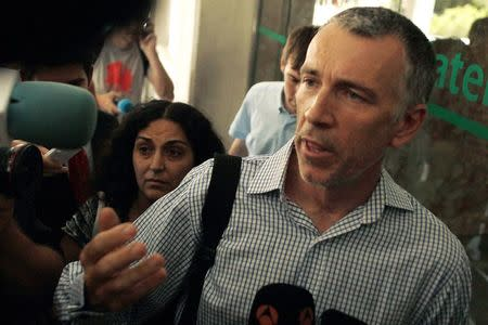 Naghemeh and Brett King, parents of Ashya King, arrive at Malaga's Materno-Infantil Hospital, where their son is hospitalized since last Saturday, in Malaga