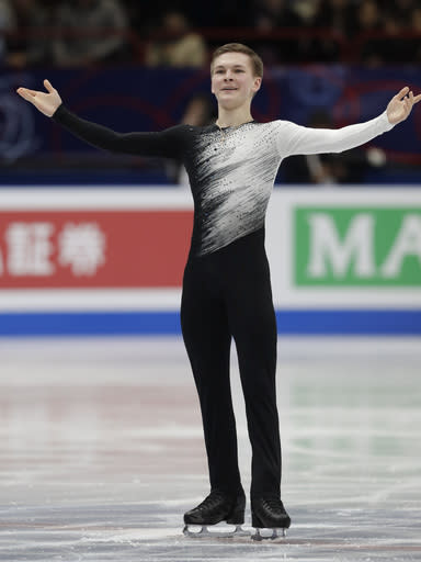 Mikhail Kolyada of Russia performs during men's short program at the Figure Skating World Championships in Assago, near Milan, Thursday, March 22, 2018. (AP Photo/Luca Bruno)