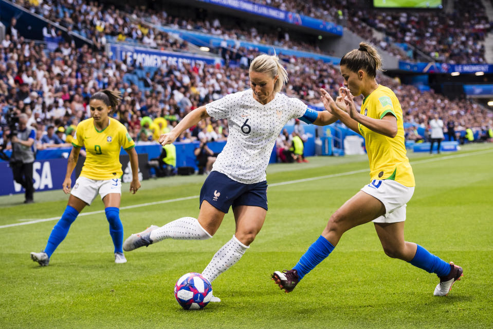 Amandine Henry of France (L) in action against Tamires Britto of Brazil (R) during the 2019 FIFA Women's World Cup France Round Of 16 match between France and Brazil at Stade Oceane on June 23, 2019 in Le Havre, France. (Photo by Marcio Machado/Getty Images)