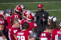 Indiana head coach Tom Allen paces the sideline in front of the team's bench during a break in the second half of an NCAA college football game against Michigan, Saturday, Nov. 7, 2020, in Bloomington, Ind. Indiana won 38-21. (AP Photo/Doug McSchooler)