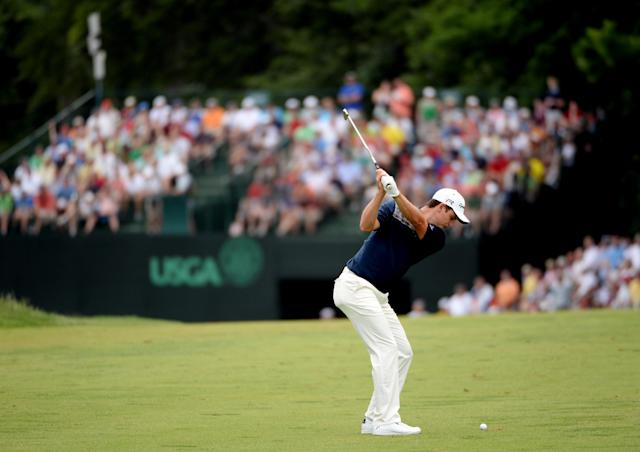 ARDMORE, PA - JUNE 16: Justin Rose of England hits his second shot on the eighth hole during the final round of the 113th U.S. Open at Merion Golf Club on June 16, 2013 in Ardmore, Pennsylvania. (Photo by Ross Kinnaird/Getty Images)