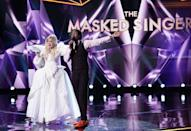 """<p>According to contestant Adrienne Bailon, the crew members who knew the cast's real identities, and contestants were therefore allowed to talk to, <a href=""""https://www.goodhousekeeping.com/life/entertainment/a30677487/masked-singer-season-3-taping-experience/"""" rel=""""nofollow noopener"""" target=""""_blank"""" data-ylk=""""slk:wear special shirts"""" class=""""link rapid-noclick-resp"""">wear special shirts</a> that say """"You Can Talk to Me."""" Smart.</p>"""