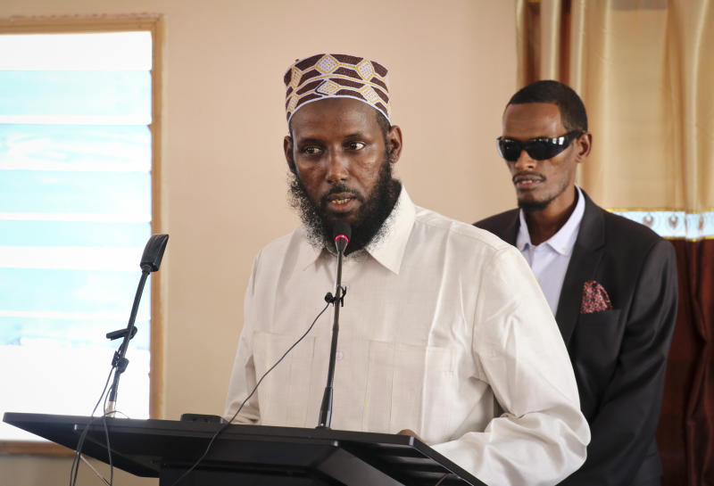 FILE - In this Wednesday, Oct. 10, 2018, file photo, Mukhtar Robow, who was once deputy leader of Africa's deadliest Islamic extremist group the al-Qaida-linked al-Shabab, speaks at a press conference about his candidacy for a regional presidency, in Baidoa, Somalia. Somalia's government on Tuesday, Jan. 1, 2019, ordered Nicholas Haysom, the United Nations envoy to Somalia, to leave amid questions over the arrest of the al-Shabab extremist group's former deputy leader Mukhtar Robow who had run for a regional presidency. (AP Photo/File)