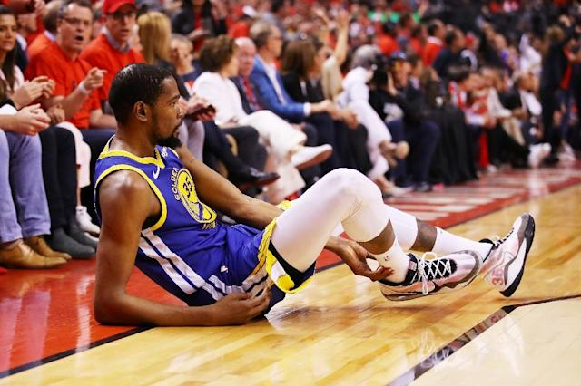 Injured Golden State star Kevin Durant will serve as an inspiration for the defending champion Warriors in Thursday's sixth game of the NBA Finals (AFP Photo/Gregory Shamus)
