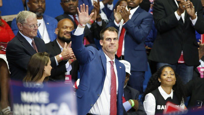 Oklahoma Gov. Kevin Stitt is recognized as President Trump speaks during a campaign rally at the BOK Center in Tulsa, Okla., on June 20. (AP Photo/Sue Ogrocki)