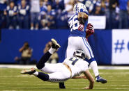 Indianapolis Colts free safety Delano Howell, top, avoids the tackle of Seattle Seahawks on his way to a touchdown on a blocked punt during the first half of an NFL football game in Indianapolis, Sunday, Oct. 6, 2013. (AP Photo/Brent R. Smith)