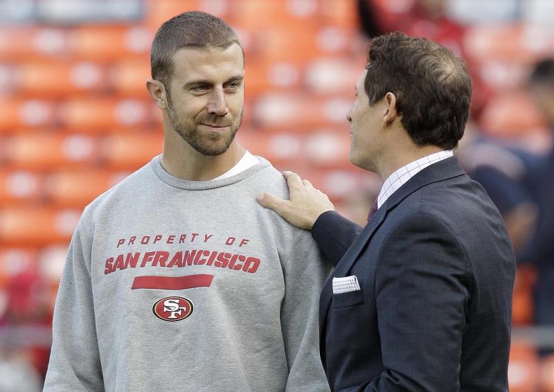 FILE - In this Nov. 19, 2012 file photo, San Francisco 49ers quarterback Alex Smith, left, talks with former quarterback and NFL broadcaster Steve Young before an NFL football game against the Chicago Bears in San Francisco. A person with knowledge of the trade tells The Associated Press that the Kansas City Chiefs have agreed to acquire Smith from San Francisco. The person spoke on condition of anonymity on Wednesday, Feb. 27, 2013, because the trade does not become official until March 12, when the NFL's new business year begins. (AP Photo/Tony Avelar, File)