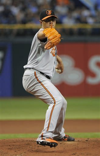 Baltimore Orioles starting pitcher Wei-Yin Chen, of Taiwan, delivers to the Tampa Bay Rays during the first inning of a baseball game on Saturday, Aug. 4, 2012, in St. Petersburg, Fla. (AP Photo/Brian Blanco)