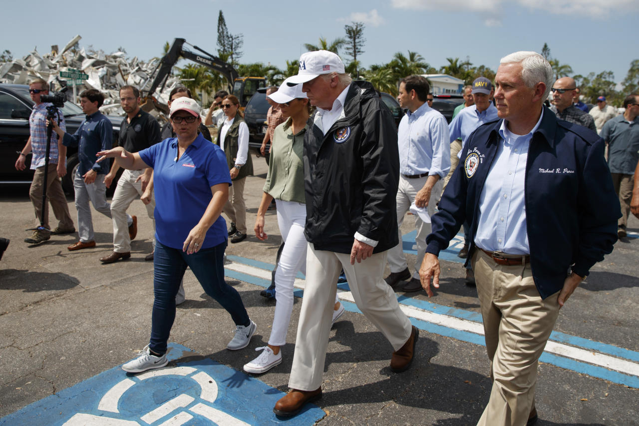 <p>President Donald Trump, first lady Melania Trump and Vice President Mike Pence, right, tour Naples Estates, a neighborhood impacted by Hurricane Irma, Thursday, Sept. 14, 2017, in Naples, Fla. (Photo: Evan Vucci/AP) </p>