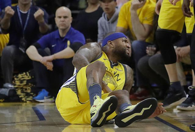 Warriors center DeMarcus Cousins reacts after injuring his left quad in Game 2 Monday night. (AP Photo/Jeff Chiu)