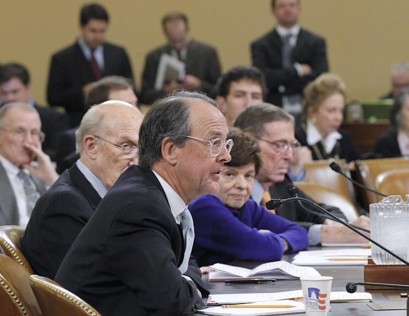 FILE - In this Nov. 1, 2011, file photo Erskine Bowles, co-chair of President Obama's Commission on Fiscal Responsibility, foreground, testifies on Capitol Hill in Washington before the  Joint Select Committee on Deficit Reduction (Supercommittee). The coming year-end spending  on the table after the failure of three high-profile efforts at big deficit deals shows how hard it is to stem the government's flow of red ink. Lawmakers are poised to renew a Social Security tax cut, and to continue unemployment benefits to people out of work for more than half a year. From left are, Bowles, former Wyoming Sen. Alan Simpson, former White House Budget Director Alice Rivlin, and former Senate Budget Committee Chairman Pete Domenici. (AP Photo/J. Scott Applewhite, File)