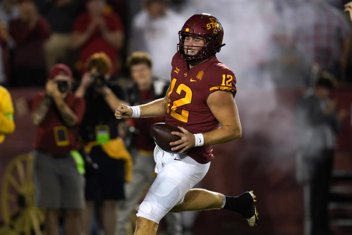 Iowa State quarterback Hunter Dekkers (12) scores on a 41-yard touchdown run during the second half of an NCAA college football game against Kansas, Saturday, Oct. 2, 2021, in Ames, Iowa. (AP Photo/Charlie Neibergall)