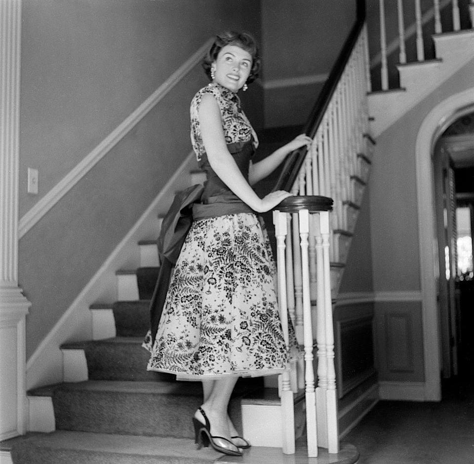 <p>The actress welcomes cameras into the foyer of her Los Angeles home, while looking chic in a floral full skirt dress. </p>