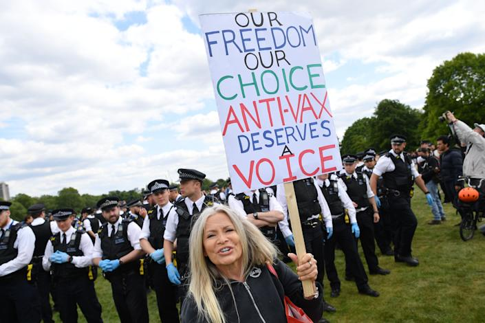 A protester carries a sign with an anti-vaccination slogan during an anti-coronavirus lockdown demonstration in Hyde Park in London on May 16. (Photo: JUSTIN TALLIS via Getty Images)