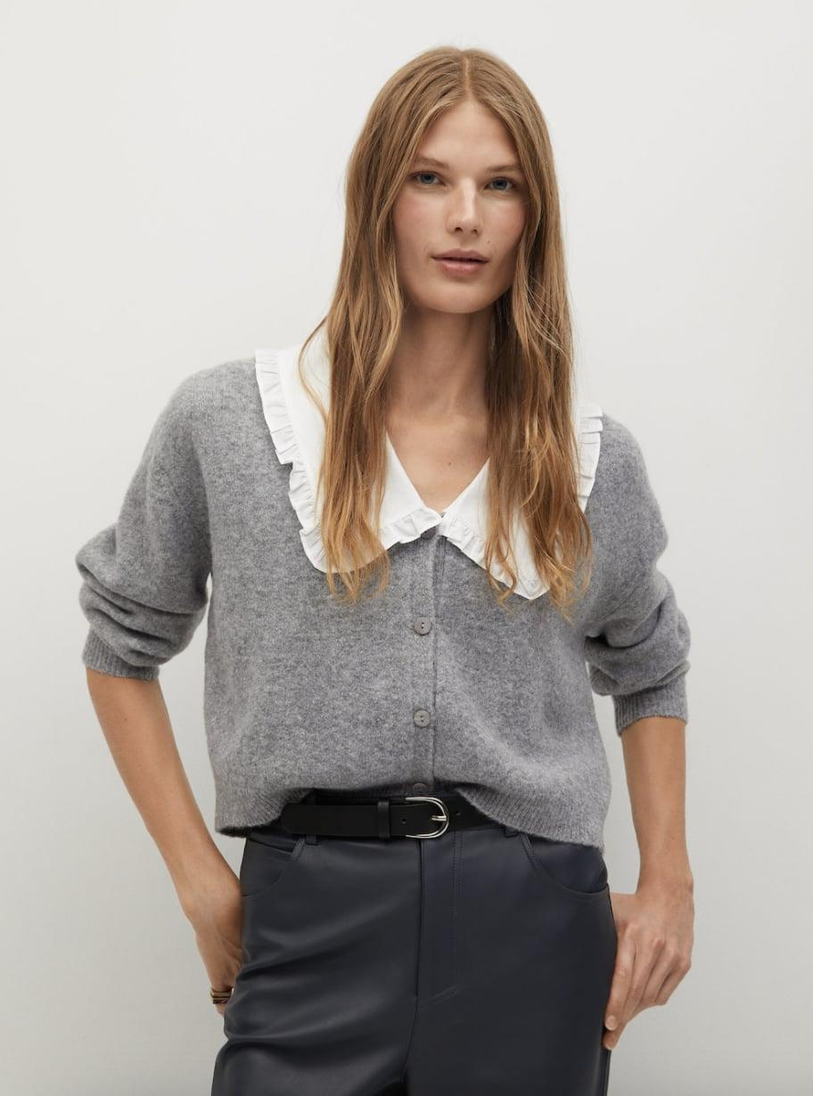 <p>This <span>Mango Baby Doll-neck Cardigan</span> ($40, originally $80) looks great with leather pants.</p>