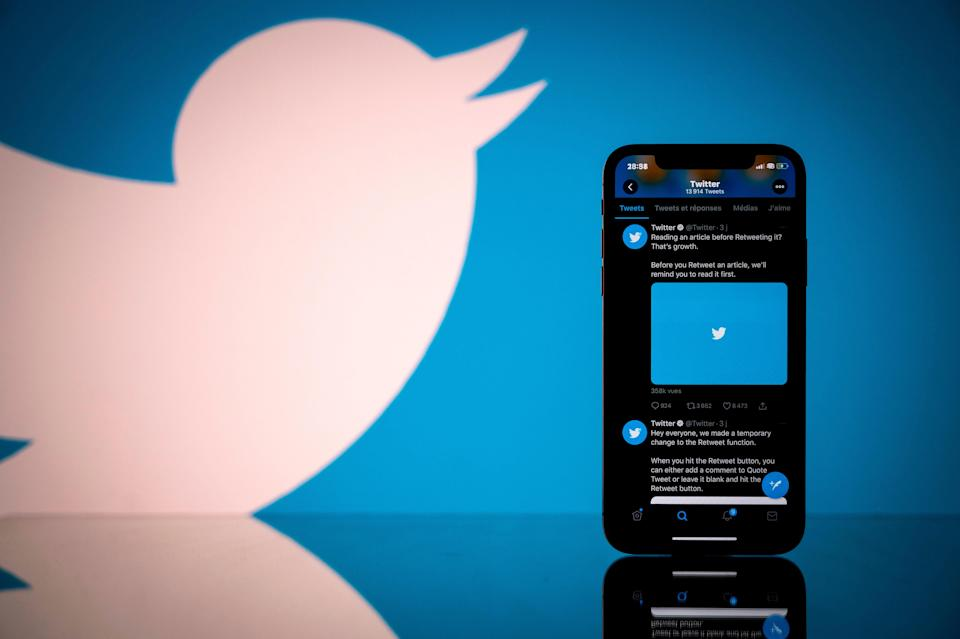 Photograph shows the logo of US social network Twitter displayed on the screen of a smartphone and a tablet in Toulouse (AFP via Getty Images)