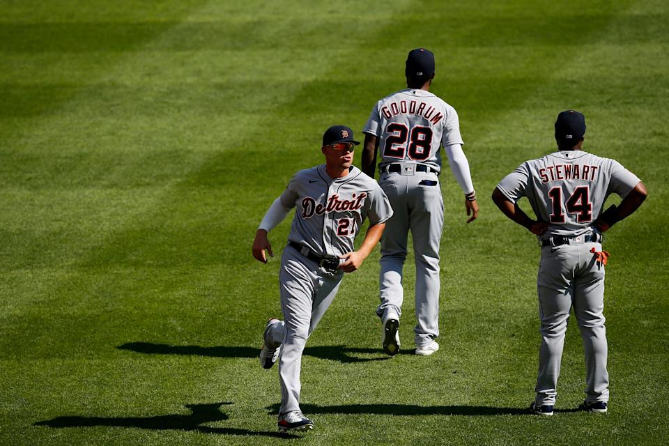 Tigers center fielder JaCoby Jones, left, warms up with shortstop Niko Goodrum and left fielder Christin Stewart before the first inning against the Cincinnati Reds in Cincinnati on Saturday, July 25, 2020.