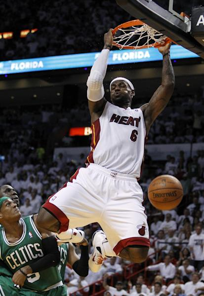 Miami Heat's LeBron James dunks over Boston Celtics' Rajon Rondo (9) during the first half of Game 7 of the NBA basketball playoffs Eastern Conference finals, Saturday, June 9, 2012, in Miami. (AP Photo/Lynne Sladky)