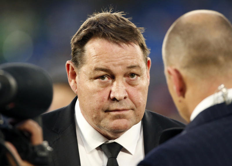 "In this Oct. 27, 2018, photo, New Zealand All Blacks coach Steve Hansen, center, speaks to the media after their Bledisloe Cup rugby test against Australia at the Nissan Stadium in Yokohama, Japan. Hansen has selected eight new caps in his squad for the match at Tokyo on Saturday, Nov. 3 ; the most rookies in one All Blacks squad since 1986 when the so-called ""Baby Blacks"" beat France while most leading players were suspended for their part in a rebel tour to South Africa. (AP Photo/Shuji Kajiyama)"