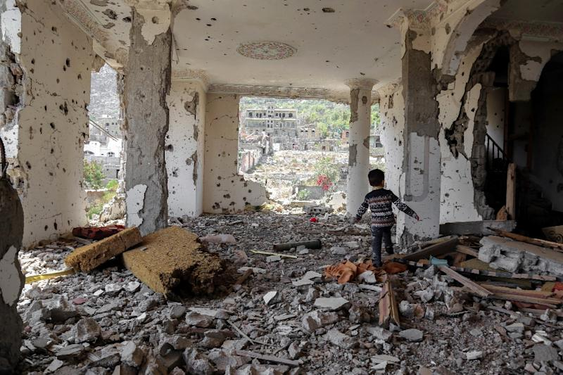 A Yemeni child walks through the rubble of a building destroyed in an air strike in the southern city of Taez (AFP Photo/Ahmad AL-BASHA)