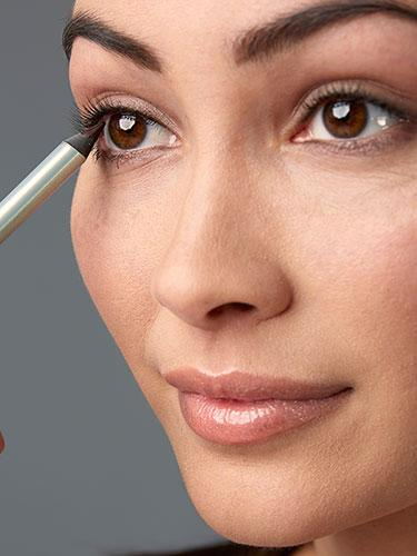 "<div class=""caption-credit""> Photo by: Brian Doben</div><div class=""caption-title"">Step 2</div>Dot black eye pencil between lashes, applying from underneath. Then blend it with a liner brush. <br> <br> <b>More from REDBOOK: <br></b> <ul>  <li>  <a rel=""nofollow"" target="""" href=""http://www.redbookmag.com/beauty-fashion/tips-advice/date-hair?link=rel&dom=yah_life&src=syn&con=blog_redbook&mag=rbk""><b>50 Knockout Date-Night Hairstyles</b></a>  </li>  <li>  <a rel=""nofollow"" target="""" href=""http://www.redbookmag.com/love-sex/advice/dates-america?link=rel&dom=yah_life&src=syn&con=blog_redbook&mag=rbk""><b>The 50 Best Dates in the 50 States</b></a><a rel=""nofollow"" target="""" href=""http://www.redbookmag.com/love-sex/advice/dates-america?link=rel&dom=yah_life&src=syn&con=blog_redbook&mag=rbk""><b><br></b></a>  </li> </ul>"