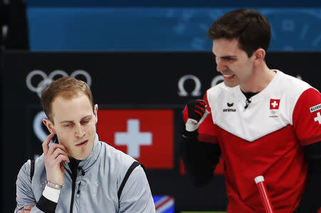 Curling - Pyeongchang 2018 Winter Olympics - Men's Tie-Breaker - Switzerland v Britain - Gangneung Curling Center - Gangneung, South Korea - February 22, 2018 - Kyle Smith of Britain and Peter de Cruz of Switzerland react. REUTERS/Cathal McNaughton