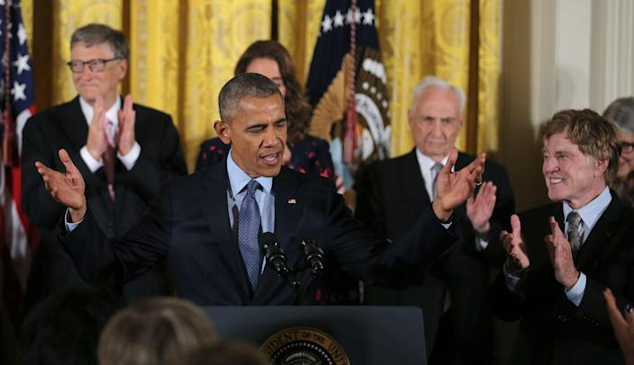 <p>President Obama is applauded by Presidential Medal of Freedom recipients, including actor Robert Redford, right, during a ceremony in the White House East Room, Nov. 22, 2016. (Carlos Barria/Reuters) </p>