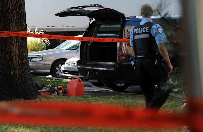 A police officer looks towards a black SUV that has had its contents removed on a crime scene outside the Metropolis in Montreal on Wednesday, Sept. 5, 2012. A masked gunman wearing a blue bathrobe opened fire during a midnight victory rally for Quebec's new premier, killing one person and wounding another. The new premier, Pauline Marois of the separatist Parti Quebecois, was whisked off the stage by guards while giving her speech and uninjured. It was not clear if the gunman was trying to shoot Marois, whose party favors separation for the French-speaking province from Canada. Police identified the gunman only as a 62-year-old man, and were still questioning him Wednesday morning. (AP Photo/The Canadian Press, Sean Kilpatrick)
