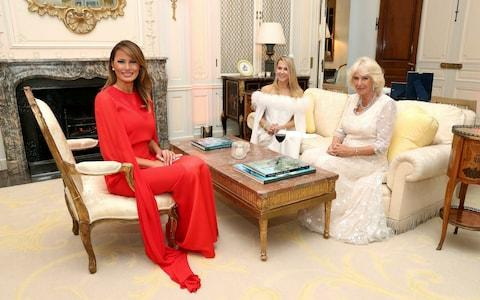 US first lady Melania Trump, left, Suzanne Ircha, wife of the US Ambassador to the UK, Woody Johnson and Camilla, the Duchess of Cornwall  - Credit: Chris Jackson/Pool Photo via AP