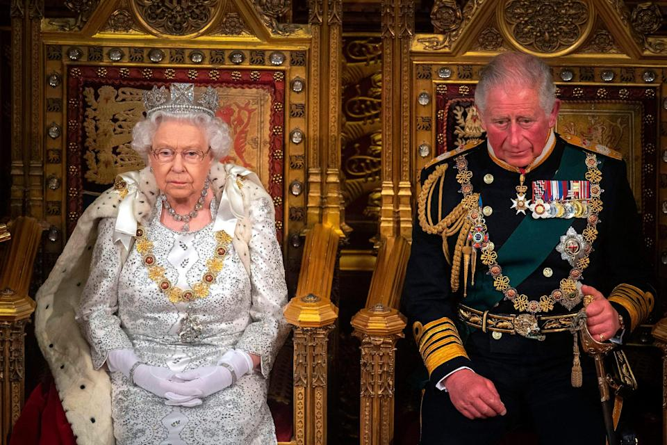 Queen Elizabeth II with Prince Charles, Prince of Wales on the Sovereign's throne to deliver the Queen's Speech at the State Opening of Parliament in London on Oct. 14, 2019.