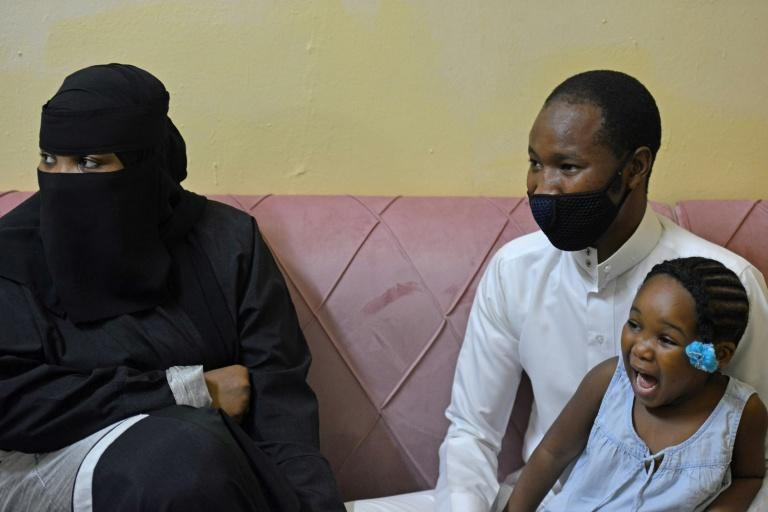 Among the chosen ones whose hajj application was  accepted, Nasser Younes Solebarmo (R), a Riyadh-based Nigerian expat, sits near his wife and daughter in Riyadh