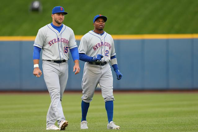Tebow has to contend with MLB veterans like Rajai Davis for playing time. (Photo by Rich Schultz/Getty Images)