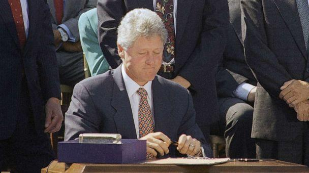 PHOTO: President Bill Clinton signs the $30 billion crime bill on the South Lawn of the White House , Sept. 13, 1994. (Dennis Cook/AP)