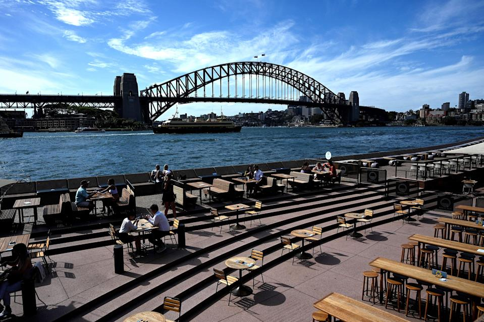 This general view shows seating for restaurants mostly empty along Sydney Harbour, usually packed with locals and tourists on Christmas Eve but now quiet due to COVID-19 coronavirus concerns, in Sydney on December 24, 2020. (Photo by Saeed KHAN / AFP) (Photo by SAEED KHAN/AFP via Getty Images)
