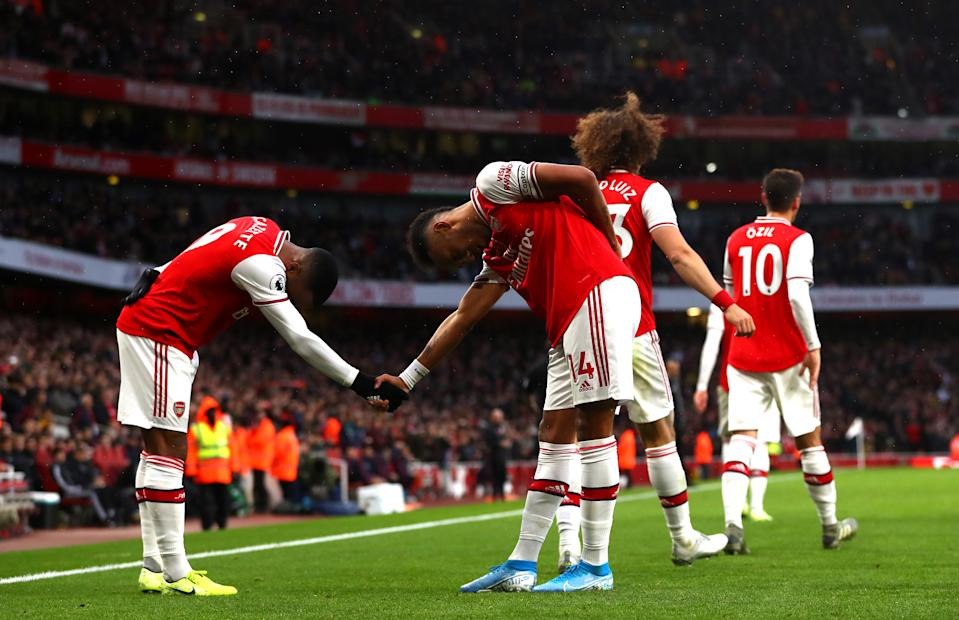 LONDON, ENGLAND - NOVEMBER 02: Pierre-Emerick Aubameyang of Arsenal celebrates scoring his teams first goal during the Premier League match between Arsenal FC and Wolverhampton Wanderers at Emirates Stadium on November 02, 2019 in London, United Kingdom. (Photo by Chloe Knott - Danehouse/Getty Images)