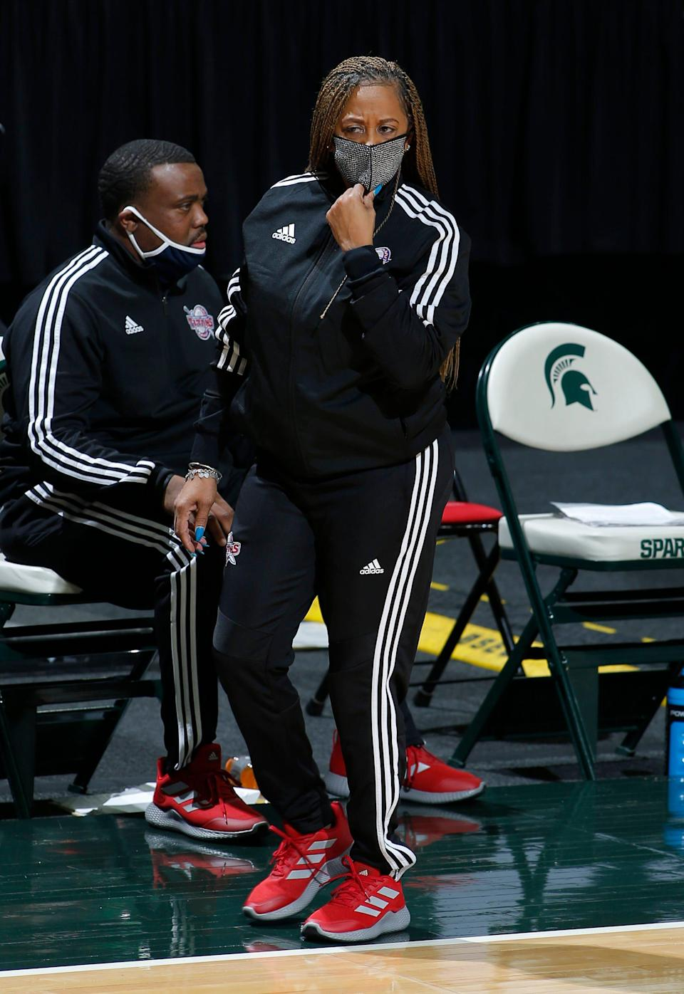 Detroit coach AnnMarie Gilbert walks the sideline against Michigan State, Wednesday, Dec. 2, 2020, in East Lansing, Mich. Michigan State won 82-45.