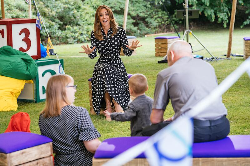 EMBARGOED TO 2230 MONDAY JULY 13 Undated handout photo issued by Kensington Palace of the Duchess of Cambridge (centre) with Kerry, Darren and their two-year-old son Dexter, to mark the launch of a new BBC education resource called Tiny Happy People.