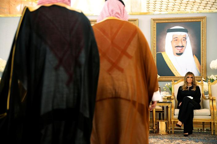 <p>First lady Melania Trump (R) takes her seat next to Saudi Arabia's King Salman bin Abdulaziz Al Saud (not pictured) as he welcomes her and U.S. President Donald Trump (not pictured) with a coffee ceremony in the Royal Terminal after they arrived aboard Air Force One at King Khalid International Airport in Riyadh, Saudi Arabia on May 20, 2017. (Photo: Jonathan Ernst/Reuters) </p>