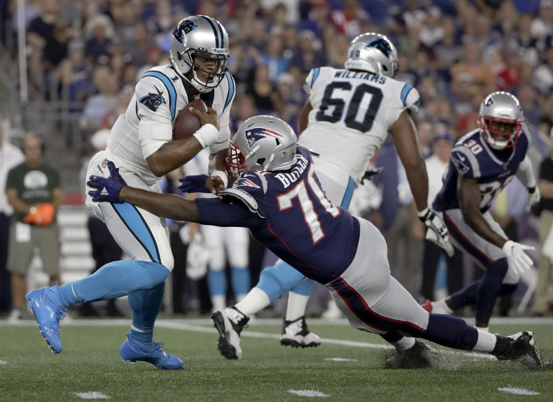 New England Patriots defensive tackle Adam Butler (70) sacks Carolina Panthers quarterback Cam Newton (1) in the first half of an NFL preseason football game, Thursday, Aug. 22, 2019, in Foxborough, Mass. (AP Photo/Elise Amendola)