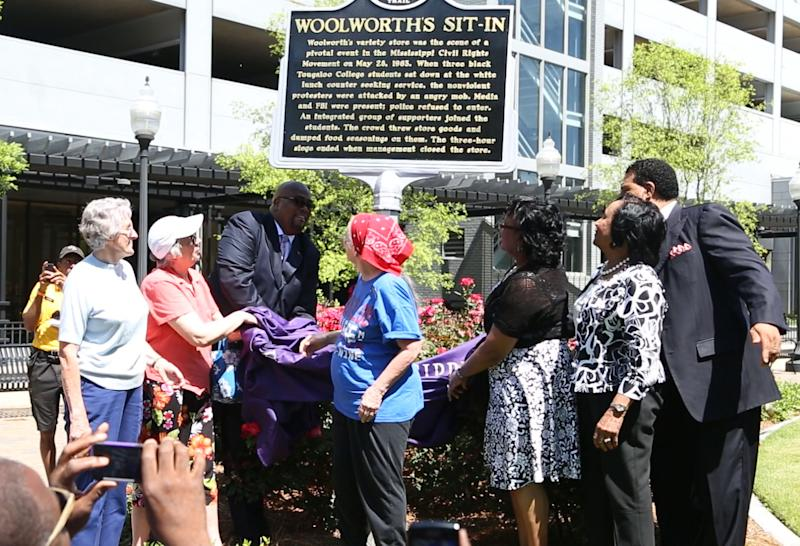 In this photo provided by Jackson State University Department of University Relations, a racially mixed group of civil rights activists help unveil a historical marker commemorating the sit-in at a Woolworth's variety store whites-only lunch counter exactly 50 years earlier in downtown Jackson, Miss., Tuesday, March 28, 2013. The event is considered  a pivotal event in breaking down state-sanctioned segregation. (AP Photo/Jackson State University Department of University Relations, Tommiea Jackson)